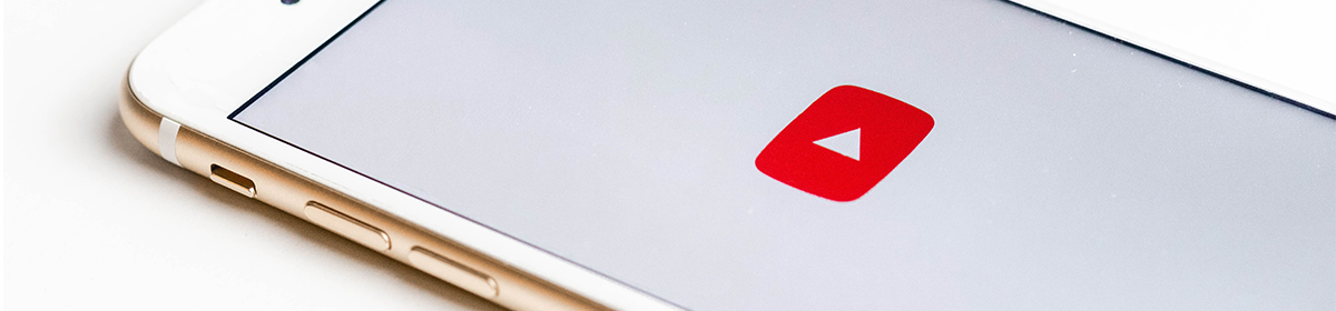 a smartphone with a Youtube icon onscreen; photo credit: sarah kurfess on unsplash